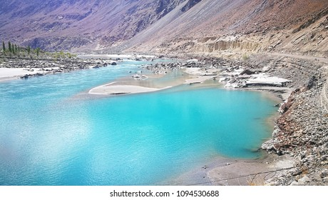 Blue crystal water of Indus river and rock mountain at Skardu, Pakistan