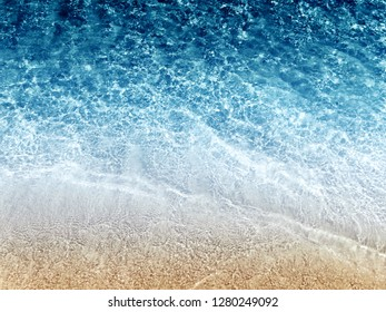 blue crystal water and white sand summer beach and holiday background with copy space