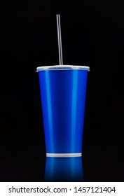 Blue cup with cap and tube isolated on black background. Concept of refreshments in cinema or watching movies