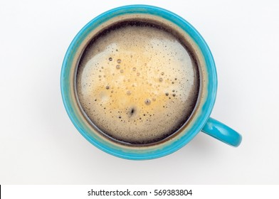 Blue cup of coffee. Espresso isolated on white, top view.