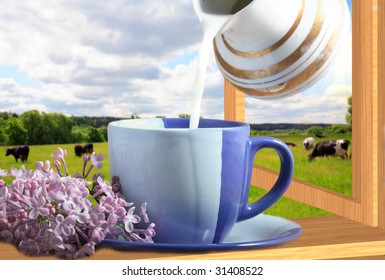Blue cup with milk and a lilac branch
