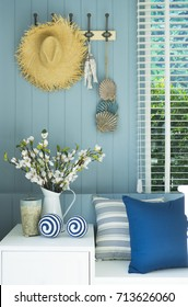 blue cushion and flower vase in coastal home