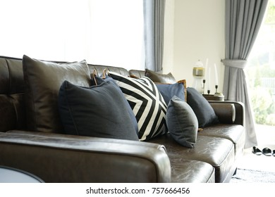 blue cushion of leather sofa