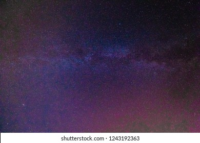 Blue dark night sky with many stars above. Milky way on the space background
