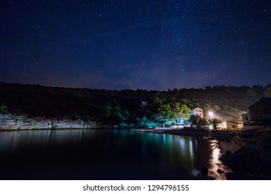 Blue dark night sky with many stars above field of trees. Bisevo island, Croatia. Milky way cosmos background - Image