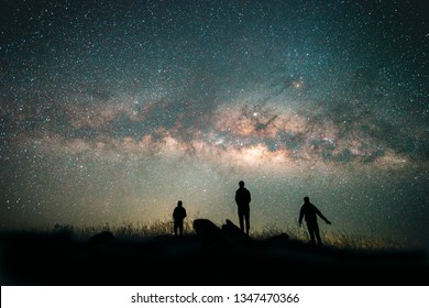 Blue dark  night sky with with star Milky way Space background and silhouette of a standing happy man