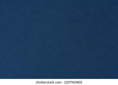 Blue dark paper background. Blue paper texture surface