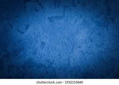 Blue decorative plaster texture with vignette. Abstract grunge background with copy space for design. - Shutterstock ID 1932155840