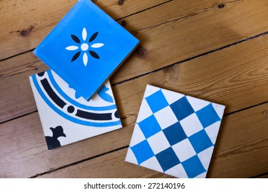Blue decorative tiles on a wooden floor