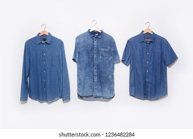 Blue denim jean shirt and blue shirt in hanging