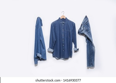 blue denim jean with two Long sleeve blue shirt on hanging -white background