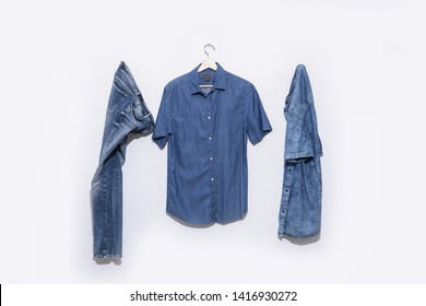 blue denim jean with two shorts sleeve blue shirt on hanging -white background