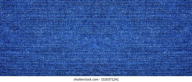 Blue denim jeans background. Seamless fabric wallpaper. Jean texture banner