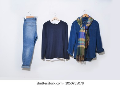 Blue denim jeans with blue shirt ,scarf on hanging