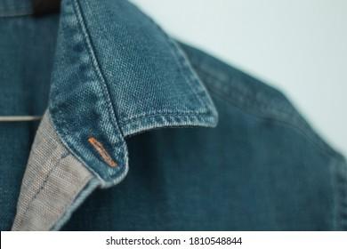 Blue denim shirt details. Close up, depth of field.