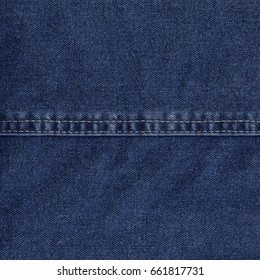 blue denim texture decorated with a seam