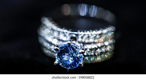 Blue diamond ring and bokeh