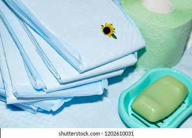 blue diapers, green toilet paper and soap closeup