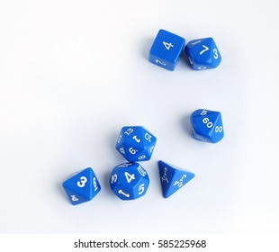 Blue dices for board games, dnd and rpg scattered on light surface