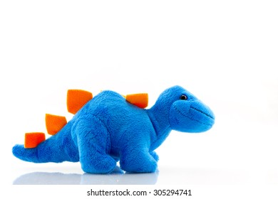Blue dinosaur plush toy isolated on white. This dinosaur doll also called stegosaurus