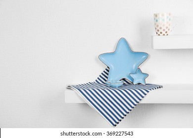 Blue dishes in form of star on a white background