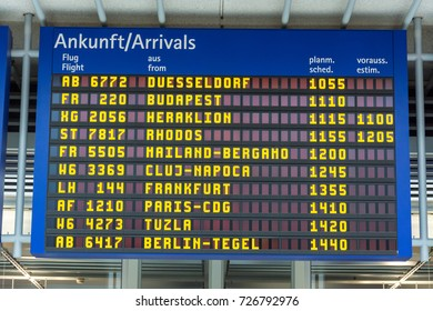 Blue display with arrivals at the airport in German and English close up