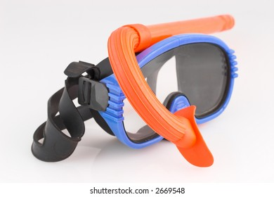 Blue diving mask and orange snorkel isolated on white