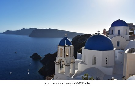 Blue dome church, overlooking the sea in Oia village on Santorini Island, Greece.