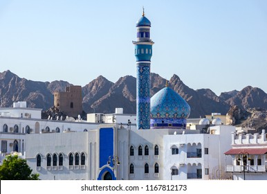 Blue Dome and Minaret of Muttrah Mosque with mountain in Background - Muscat, Oman