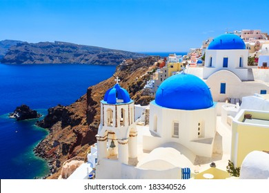 Blue domed churches on the Caldera at Oia on the Greek Island of Santorini.