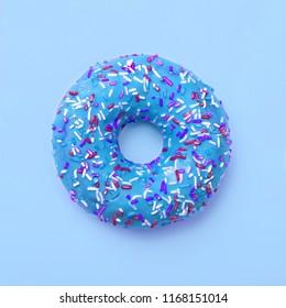 Blue donut in glaze on a blue background. Great fresh tasty cyan donut drizzled with glaze