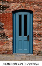 Blue Door and brick wall in an old part of town