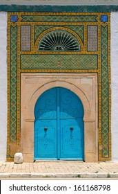 Blue door and detail of North African arab architecture - ornaments around the doors