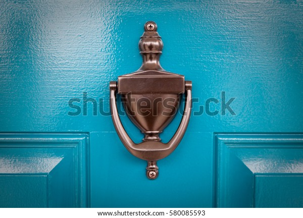 Blue Door  -  Freshly painted blue front door with bronze knocker
