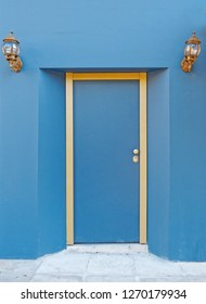 blue door with golden frame and lights on blue wall, space for text