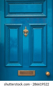 Blue door knocker and letterbox concept