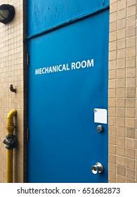 Blue door to a mechanical room.