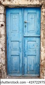Blue door in an old building