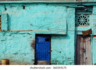 Blue door on a textured blue wall of a rural village house