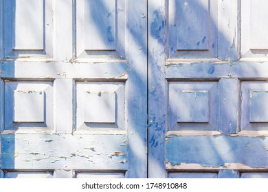 Blue door with squre pattern and peeling paint