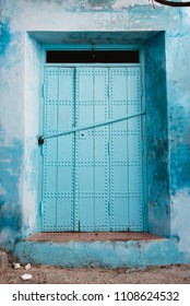 Blue Door with Blue Stone Wall, Chefchaouen, Morocco
