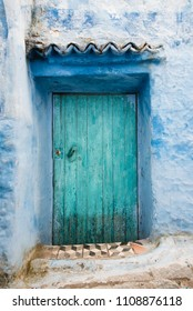 Blue Door and Blue Stone Wall in Chefchaouen Medina, Morocco