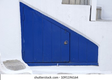 Blue door, trapezoid shape of the small room under ladder