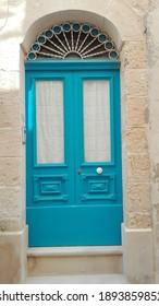 blue door in a wall
