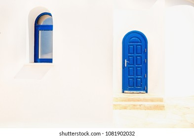 Blue door and window of one of buildings in Cyprus