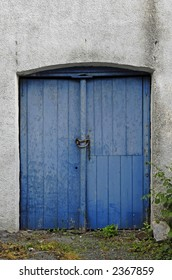 Blue doors in a white wall