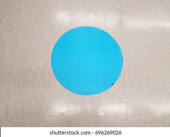 blue dot on the floor