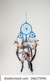 Blue dreamcatcher with brown and black feathers