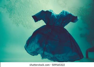 Blue Dress Floating in Pool
