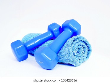 Blue dumbells  and towel